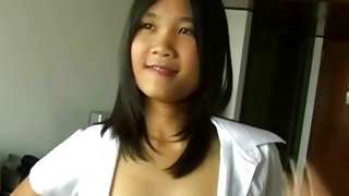 Asian sluttish babe is posing lovely with small tits