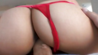 Brutal guy is pinching her butt while babe riding on the dong