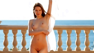Magnificent chick looks pretty while posing nude outdoors
