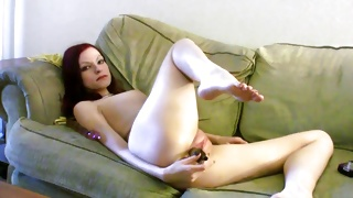Red haired fascinating beauty masturbating the sweet pussy