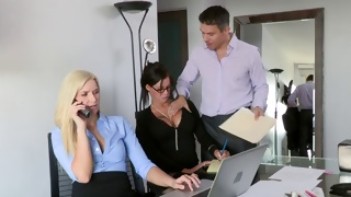 Horny guy is in the office trying to seduce these babes