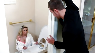 Horny bitchy babe is eating on the toilet