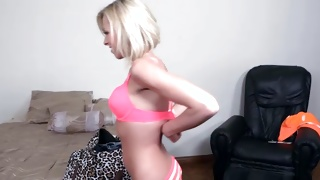 Perfect bitch is undressing herself before a dude