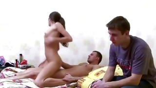 One boy is watching his girlfriend making out with a horny dude