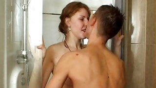 Ripped guy is in the shower room and getting his stick slurped off